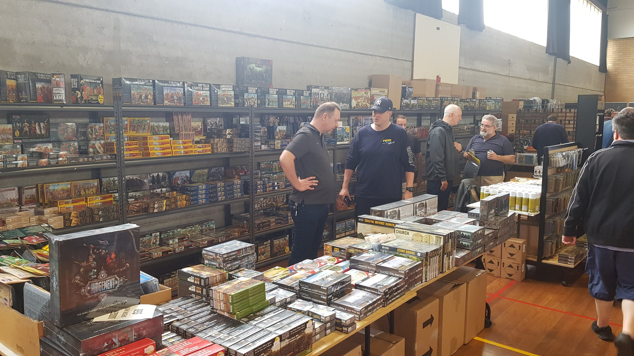 Our good friend Ian Crabb (left) from War & Peace Games talking with customers