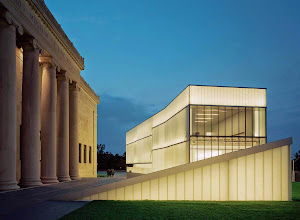 "Photo: The solid limestone edifice of the original Nelson-Atkins Building with one of the Bloch Building's five ""lanterns,"" designed by Steven Holl."