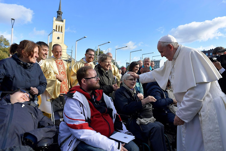 Pope Francis greets people as he arrives to lead a Holy Mass at Freedom Square in Tallinn, Estonia, September 25 2018. Picture: VATICAN HANDOUT/REUTERS