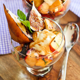 Grilled Fruit Salad with Creamy Goat Cheese Topping [and Pomegranate Agrodolce]
