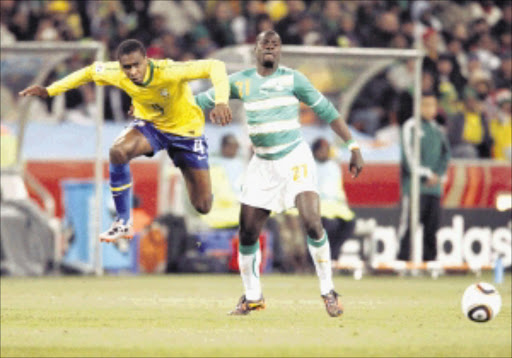 talented: Brazilian striker Juan clears the ball from Ivory Coast defender Emmanuel Eboue during their World Cup match at Soccer City in Johannesburg on Sunday evening. Pic. ANTONIO MUCHAVE.  20/06/2010. © Sowetan.