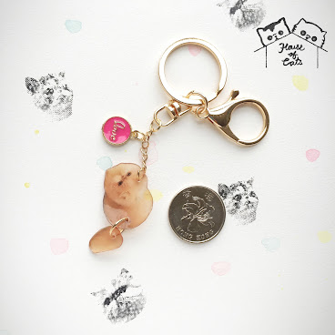 Kiki moving tail translucent keychain