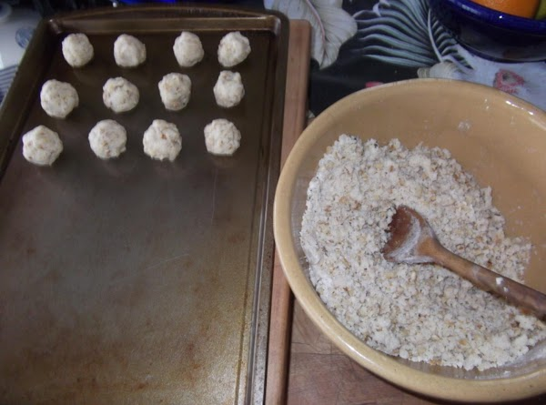 Shape dough into balls and place on cookie sheet, an inch apart.