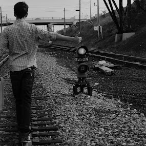Take me to California. by Jesse Hebert - City,  Street & Park  Street Scenes ( sweater, windsor, fashion, walking, canada, black and white, train track, california, track, courage, ontario, courageous, lights, urban, daring, railway, style, plaid, rail, train, dare )