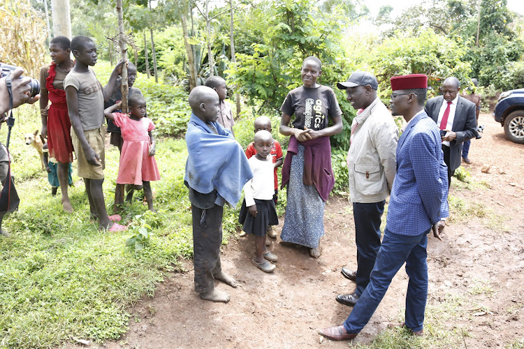 Deputy President William Ruto chats with children when he toured Kimilili Constituency in Bungoma County.