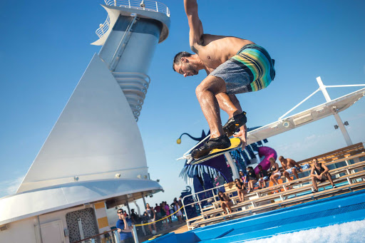 Harmony-of-the-Seas-instructor-flowrider.jpg - An instructor shows off an advanced move on FlowRider aboard Harmony of the Seas.