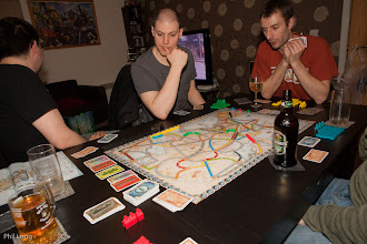 Photo: Tufty, Varls and Carl at the table playing Ticket to Ride.