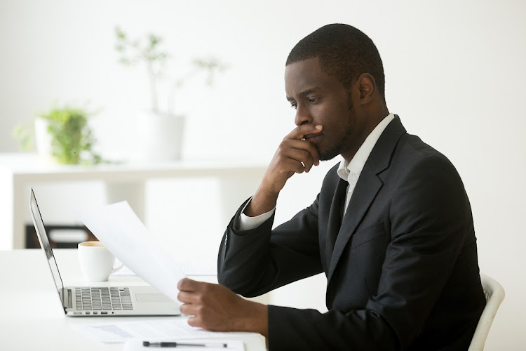 A male reading the cover letter.