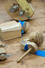 Photo: The knobs on the tools are turned.  He glues the brass pieces in and glues the top on and turns to final shape.