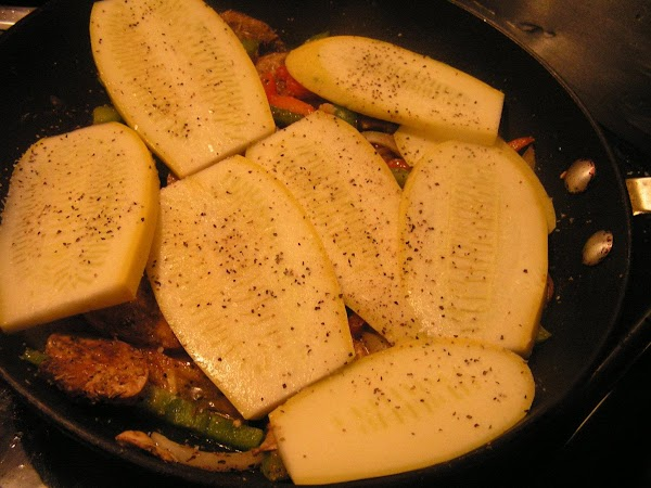Once veggies start to get tender, add a layer of sliced of squash on...