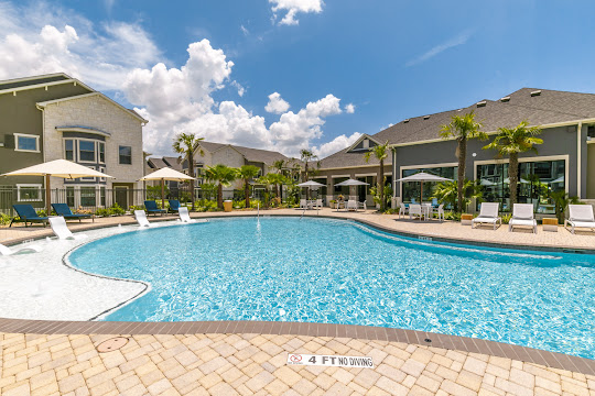 Exterior apartment building view with pool and sundeck area