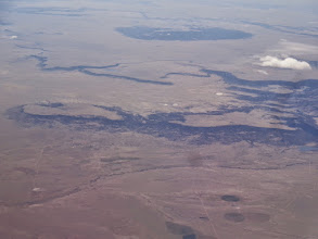 Photo: In the distance is Turkey Mt, NM, in the middle a mesa or butte that has Charette Lake and much smaller Upper Charette Lakes barely visible on the eastern edge, and at center right is Rayado Mesa, with Gonzalitos Mesa at center left.  Miami Lake is at the extreme right center, below Rayado Mesa.  The dark line wending along the bottom is Rayado Creek.  All of this is right to the east of Philmont Scout Ranch.