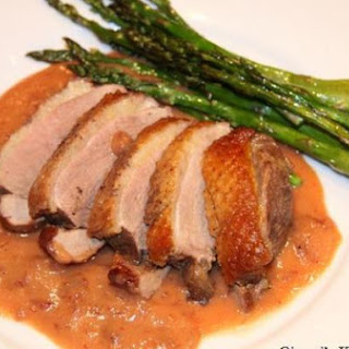 Duck with Dried Cranberries, Tangerines and Mascarpone Sauce.