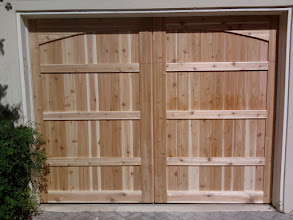 Photo: This is an unfinished wood door we completed using Cedar with Smooth side out. Cedar Park Overhead Doors. Call us today at 512-335-7441