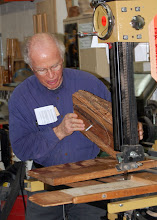 Photo: Phil Brown demonstrates his jig for cutting a circular bowl blank on the band saw.