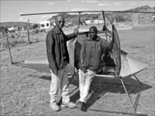 HIGH AMBITIONS: Designers Moses Seete and Lucas Kuta proudly present their flying machine. PIC: MONTSHO MATLALA. 15/10/2009. © Unknown.