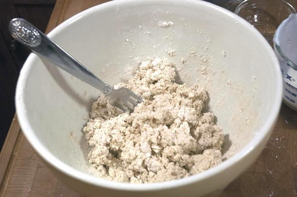 Mix in the cold buttermilk, and incorporate using a fork, until the dough is...