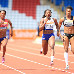Leading Ladies.  by Ron Russell - Sports & Fitness Running ( grace, athletics, speed, female, muscles, action, running )