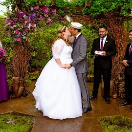 Rainy Kiss by Matthew Chambers - Wedding Ceremony ( love, bride, rain, dress, wedding dress, groom, beauty, bride and groom, interracial, kissing, wedding, kiss )