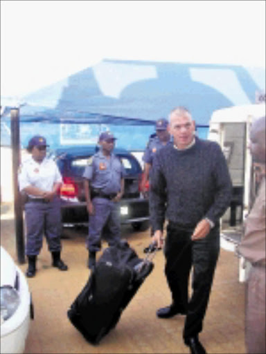 EARLY PAROLE: The police were out in full force when Mark Scott-Crossley was released from the Bushbuckridge correctional services centre yesterday. Pic. Riot Hlatshwayo. © Sowetan.
