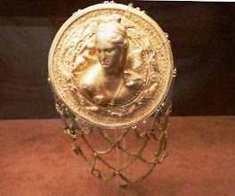Photo: Gold hairnet of Aphrodite with Eros and holding a fan, 3rd century BC