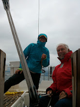 Photo: Anne at the helm on a grey cool morning