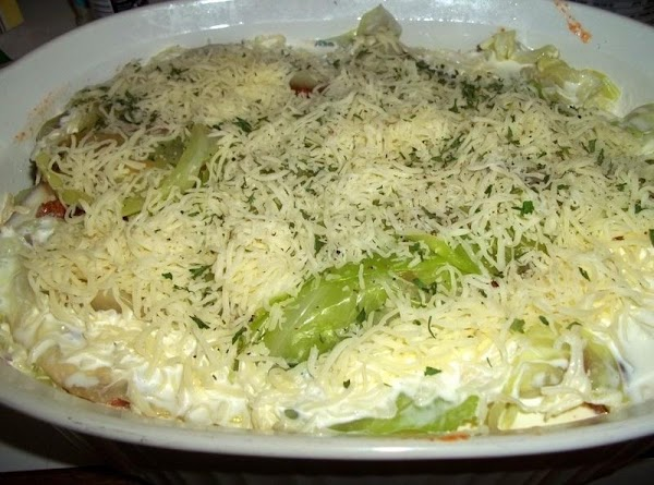 Repeat layers ending with cabbage and cheese ( should be 3 layers in all)  Pour...