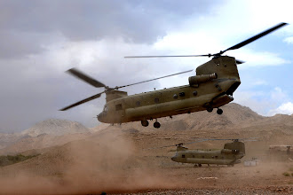 Photo: A U.S. Army CH-47 Chinook helicopter from the 101st Airborne Division takes off after dropping supplies at Forward Operating Base Baylough in the Zabul province of Afghanistan to Soldiers with Delta Company, 1st Battalion, 4th Infantry Regiment June 7, 2010. The Soldiers were deployed from the Joint Multinational Readiness Center in Hohenfels, Germany, in support of Operation Enduring Freedom. (U.S. Army photo by Staff Sgt. William Tremblay/Released)