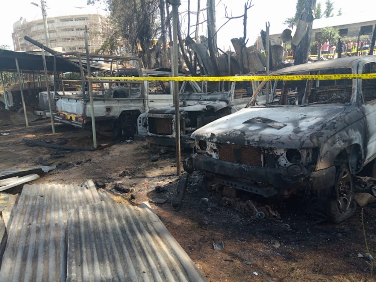 Some of the burnt vehicles in a yard at Kapenguria on Monday, March 25, 2019.
