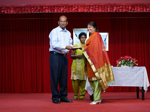 Photo: Mrs Chitra Chandra, the co-ordinator of theTAPAS Reading Program receiving a token of appreciation.