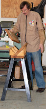 Photo: For people without band saws, Gary Guenther switches the topic to cutting logs and trimming blanks with an electric chain saw.  The first step is putting together his simple, portable sawbuck made from some 2x10's mounted on a metal stand to bring the sawing to an ergonomic working height.