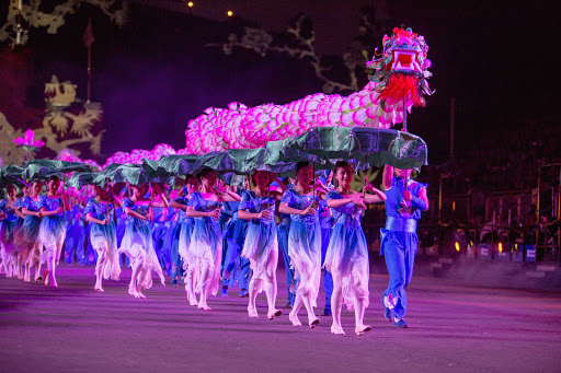 Changxing Lotus Dragon Dance Folklore Group performs at the Royal Edinburgh Military Tattoo pagent in Scotland.