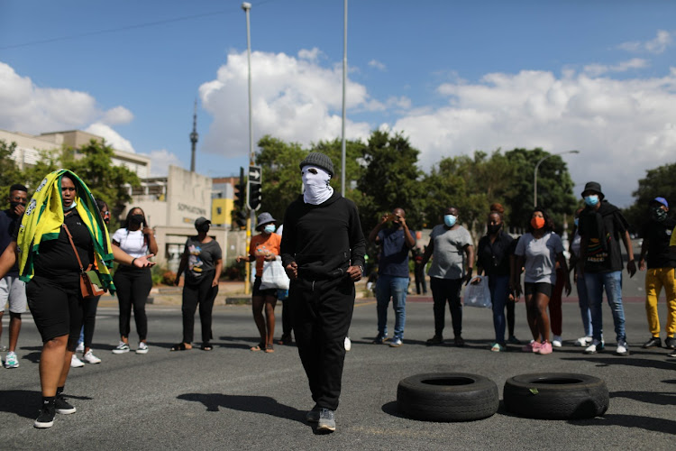 Protesting Wits students blockaded roads outside the university on Monday.