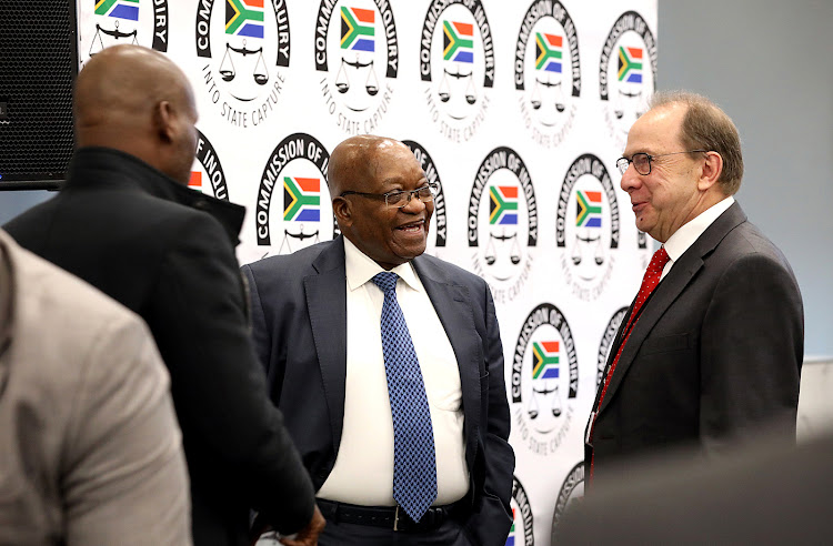 Former president Jacob Zuma shares a light moment with evidence leader Paul Pretorius during a tea break at the state capture inquiry where he continues to give testimony on Tuesday.