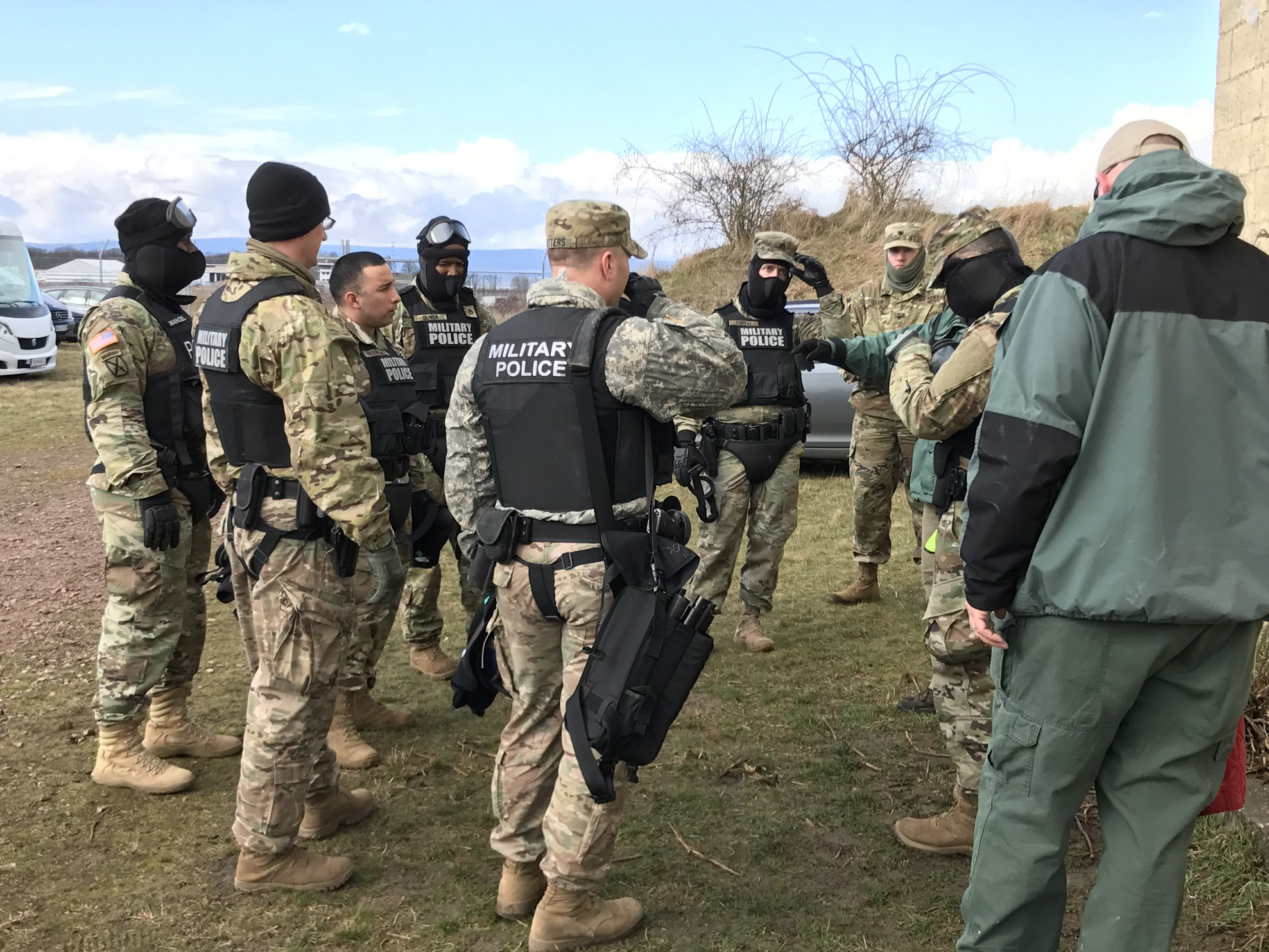 Joe Willis and Tim Sharpee doing an After Action Review with Military Police Soldiers following a scenario that required breaching, low light, and TC3 tactics.