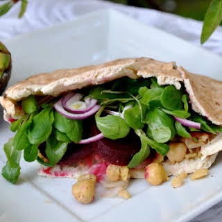 Chickpea Pita Stuffed with Hummus, Sliced Beets, Red Onions & Greens.