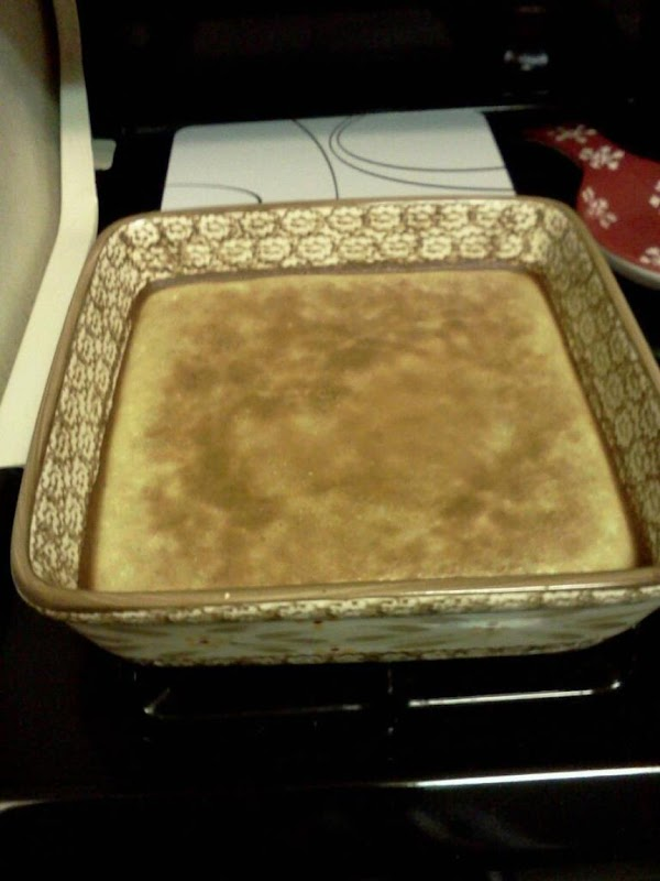 When crust is light golden around edges, pour filling over hot crust and return...