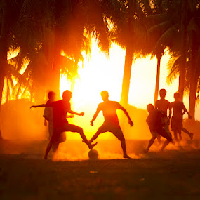 by Felix Hug - Sports & Fitness Soccer/Association football ( football, indonesia, outdoors, asia, palm trees, getaway lombok, lombok, people, south east asia, island, soccer, silhouette )
