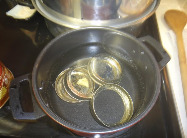 Clean you jars in the dishwasher.  Place lids and rims in a pan....