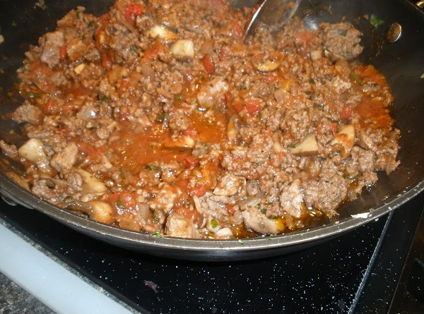 Meanwhile prepare meat. Cook ground chuck, drain off liquid. Add chopped sirloin, tomatoes, garlic,...
