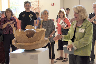 Photo: Lynda Smith-Bugge talks about her work.  She is a Friend of MCW, and that center piece is turned!