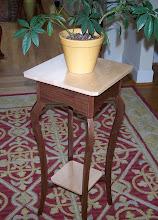 Photo: Plant stand.  Walnut with maple shelves. Elegant lines make this stand one of my favorites.  I've made many of these using a variety of woods and combinations.  12 inches wide, 12 inches deep, and 28 inches high.