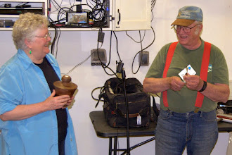 Photo: Thanks to Margaret Lospinuso, Chesapeake Woodturners member and good friend of MCW, for volunteering to lead our Show Tell & Ask session.  Here she brings Bob Grudberg's Beads of Courage donation -- a segmented, walnut, lidded bowl to him...