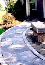 Photo: Mixing natural stone flag with cast stone pavers works well visually.