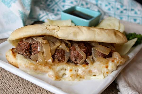 French Onion Meatball Sub With Melted Cheese.