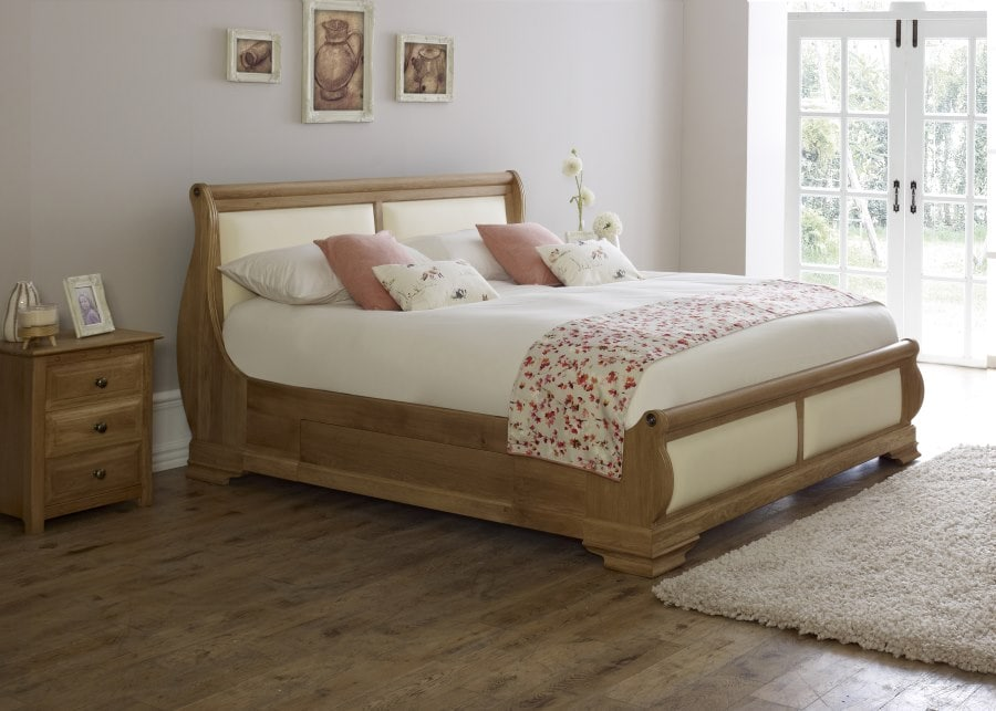 The Amalfi Sleigh Bed in Natural Oak with Cottonseed leather