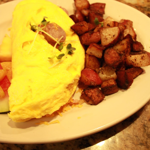 Peameal Bacon, Sausage, Bacon and Cheddar Omelette.