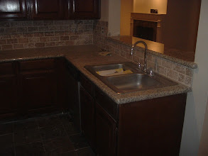 Photo: counter top marble W/ brick design Turkish tiles.