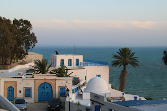 Photo: White-washed walls, blue doors an windows, the sea in the background palm trees, and mint tea. Does it get any better?