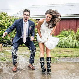 Jump by Drew Noel - Wedding Bride & Groom ( water, drew noel photography, rainy day wedding, fun, puddle, jump )